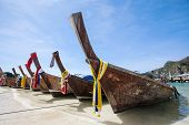 stock photo of long beach  - Long tailed boat on beautiful sand beach of Thailand - JPG