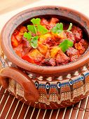 image of stew pot  - Bulgarian oven baked meat and vegetable stew in a pot - JPG