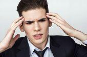 pic of nervous breakdown  - Man feeling headache - JPG