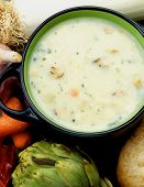 image of leek  - Healthy Artichoke Creamy Soup with Raw Leek Carrot Garlic and Cheese in Dark Blue Pannikin closeup - JPG