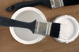 pic of paint pot  - Painting and decorating shallow focus top down view of a pot of white paint and brush - JPG