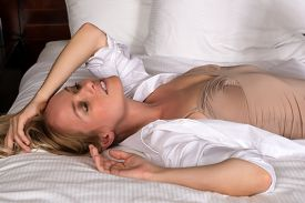picture of leotard  - Beautiful young blonde woman in a leotard and white shirt - JPG