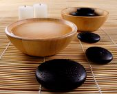 stock photo of massage therapy  - black pebbles massage therapy stones - JPG