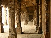 picture of hindu temple  - Atmosphere of mystery among the ruins of a temple at Qtub Minar Delhi India - JPG