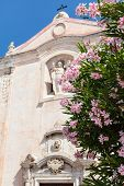 Flowers And Church San Giuseppe In Taormina City poster