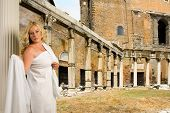 foto of toga  - woman in toga with a view of trajans market and the roman forum - JPG