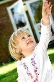 Girl Toddler Reaching Up High Outdoor poster