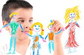 foto of 6 year old  - Adorable 6 years old boy painting his family on glass - JPG