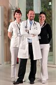Reliable doctor in between two beautiful nurses at hospital s lobby - a series of HOSPITAL IMAGES