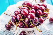 Cherries. Cherries. Fresh Sweet Cherries. Delicious Cherries With Water Drops In Bowl On Table poster