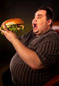 Diet failure of fat man with fast food hamberger. Overweight person who spoiled healthy food by eati poster