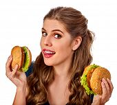 Woman eating hamburger. Student consume fast food on table. Teaches to cook and shares recipes. Girl poster