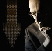 foto of depreciation  - Portrait of businessman in suit worried about Euro currency depreciation - JPG