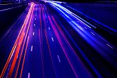 Cars Light Trails On A Curved Highway At Night. Night Traffic Trails. Motion Blur. Night City Road W poster