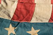 picture of waving american flag  - close up of a section of an antique american flag - JPG