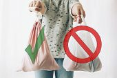 Ban Single Use Plastic, Stop Sign. Choose Plastic Free. Zero Waste Shopping Concept. Woman Holding I poster
