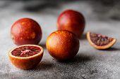 Fresh Ripe Red Oranges On Dark Background. Healthy Orange Fruits Background Many Orange Fruits. poster