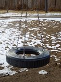 foto of tire swing  - A picture of a tire swing on playgroup in winter - JPG