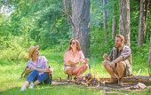 Take A Break To Have Snack. Company Hikers At Picnic Roasting Marshmallows Snacks. Company Friends P poster