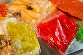 Colorful Vegetables Preserved In Vacuum Packed Bags poster