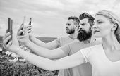 Selfie Brought By Self Confidence. Pretty Woman And Men Holding Smartphones In Hands. Best Friends T poster