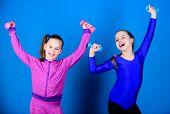 Children Hold Dumbbells Blue Background. Sport For Teens. Easy Exercises With Dumbbell. Sporty Upbri poster
