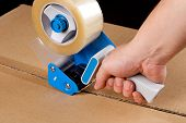 picture of dispenser  - Cardboard boxes stick dispenser for adhesive tape - JPG