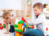 Children Boys playing with construction set on the floor.Educational games for kids. Kindergarten