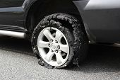 pic of blown-up  - damaged truck tire after tire explosion at high speed - JPG