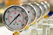 stock photo of gage  - Hydraulic Pressure Gauges installed on Hydraulic Equipment - JPG