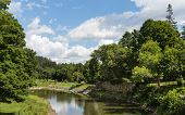 stock photo of woodstock  - This image was taken from the Woodstock Middle Bridge showing a tranquil river wandering through the Vermont greenery - JPG
