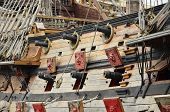 stock photo of galleon  - Cannons on the side of a pirate galleon - JPG