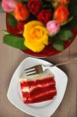 stock photo of red velvet cake  - Red Velvet Cake with Roses in the background - JPG