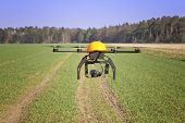 stock photo of drone  - Flying drone over a field in northern Germany - JPG