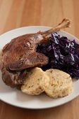 Roasted goose leg with braised red cabbage and dumplings