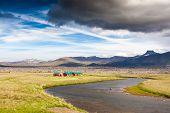 image of iceland farm  - Red houses next a river in icelandic countryside - JPG