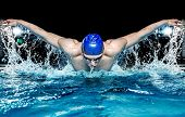 stock photo of competition  - Muscular young man in blue cap in swimming pool - JPG