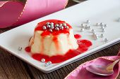 Panna cotta Italian dessert made by simmering together cream, milk and sugar, mixing this with gelat