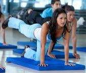 stock photo of young adult  - Group of people at the gym in a stretching class - JPG