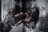 stock photo of scary haunted  - The Scary Zombie girl in haunted house - JPG
