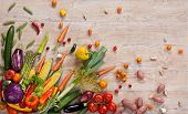 picture of eatables  - studio photography of different fruits and vegetables on wooden table - JPG