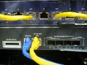 foto of chassis  - Console cable communications switch equipment installed chassis in large data center - JPG