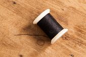 foto of thread-making  - The wood Background with many colored thread - JPG