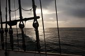 picture of galleon  - Ancient navigation gear at sunrise - JPG