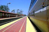 stock photo of amtrak  - Train stopped along a platform at a station - JPG