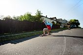 stock photo of skate board  - Long boarders skating on an urban road - JPG