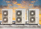 pic of air compressor  - Air compressor on pedestal with sky background - JPG