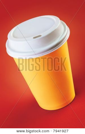 Picture or Photo of Cup of take-out coffee on a red background
