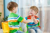image of daycare  - two friends children boys play together indoors - JPG