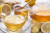 foto of ginger  - Cup of ginger tea with honey and lemon on wooden table - JPG
